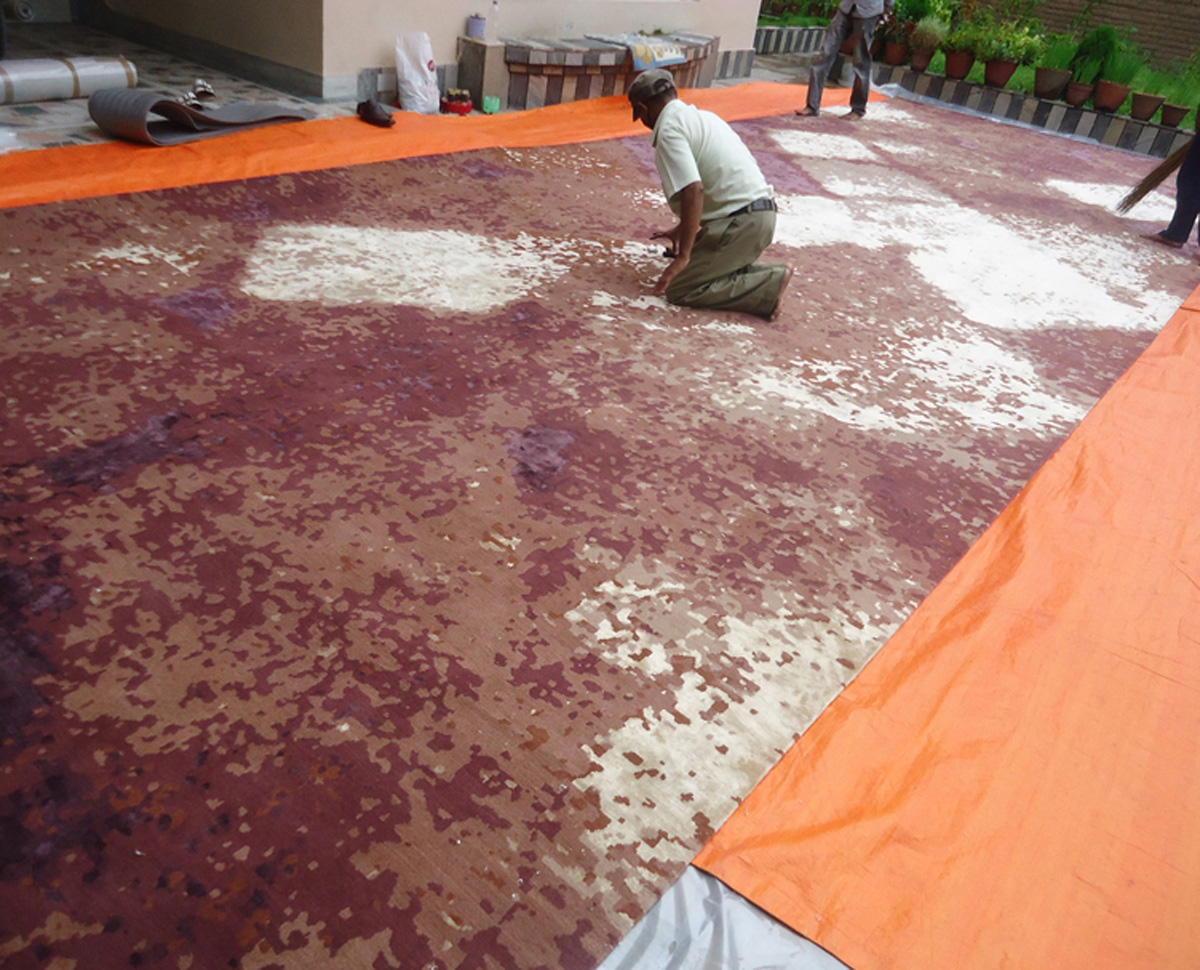 Rug Manufacturing - Inspecting finished custom Wool and Silk rug in Nepal