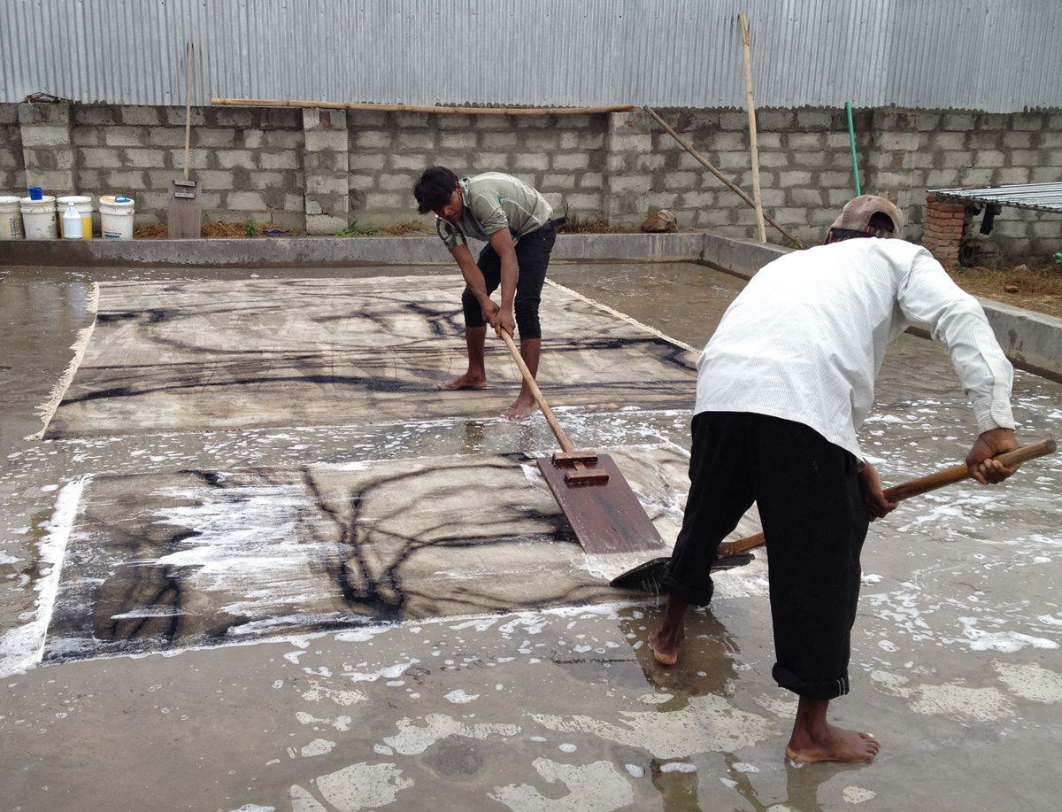 Rug Manufacturing - Washing Waterlines Wool and Silk rugs by hand in Nepal